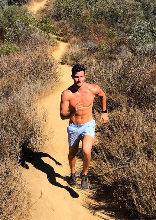 Drew Harrisberg running shirtless at Temescal Canyon in November 2018