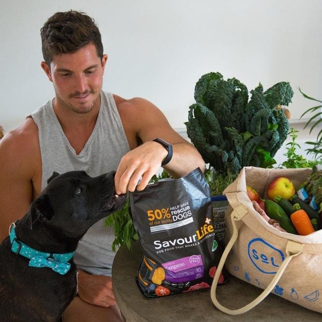 Drew Harrisberg with his dog Dennis in November 2018